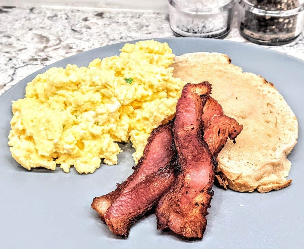 scrambled eggs served with sourdough toast and bacon