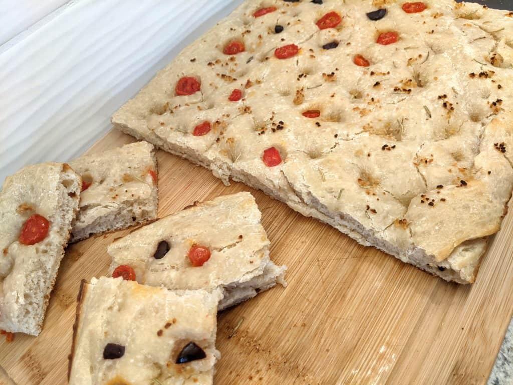 sourdough focaccia bread slices on wooden board