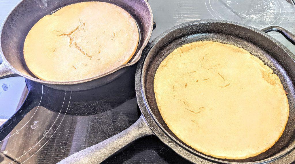 2 sourdough pizza crusts in cast iron pans
