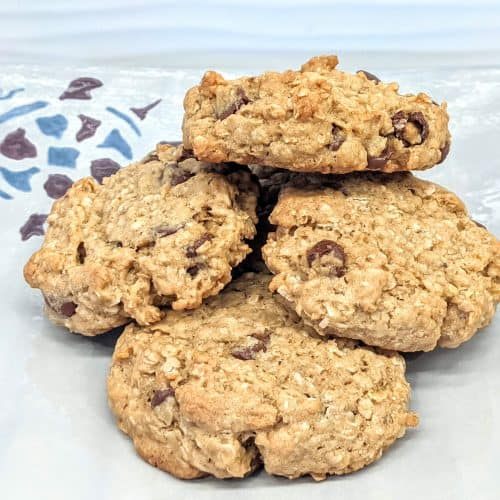 oatmeal chocolate chip cookies on a plate with a painted turtle in the background
