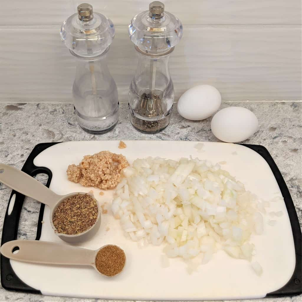 ingredients for burgers on cutting board