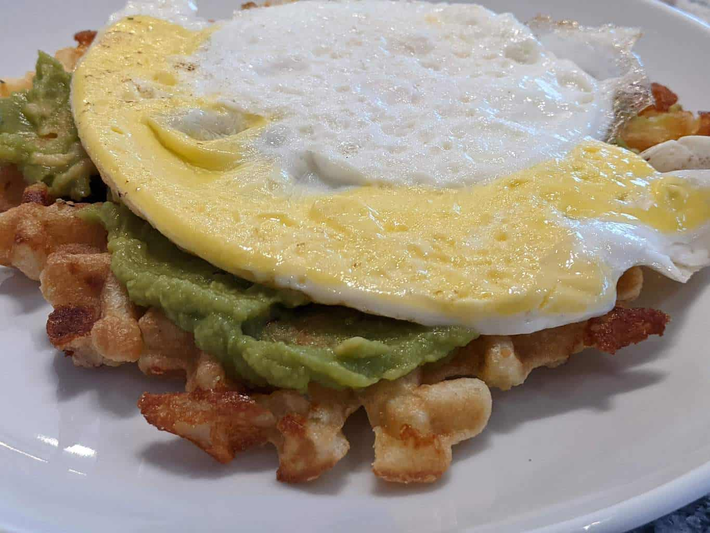 fried egg, avocado spread on a chaffle