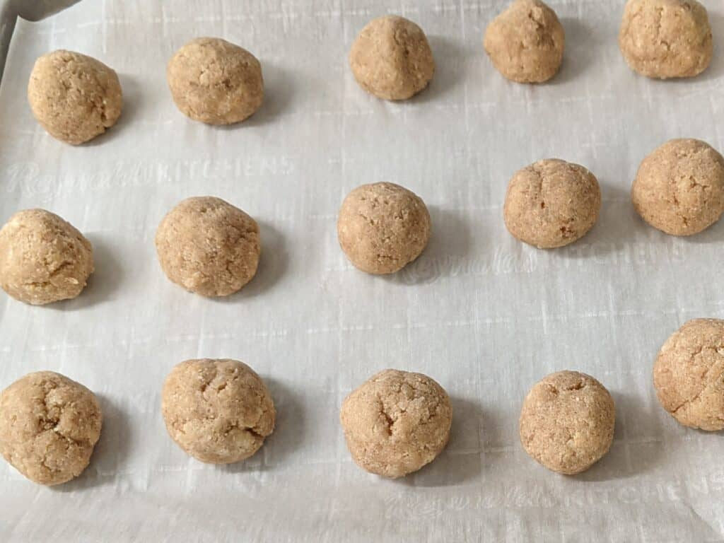 donut holes on a baking sheet covered with parchment paper