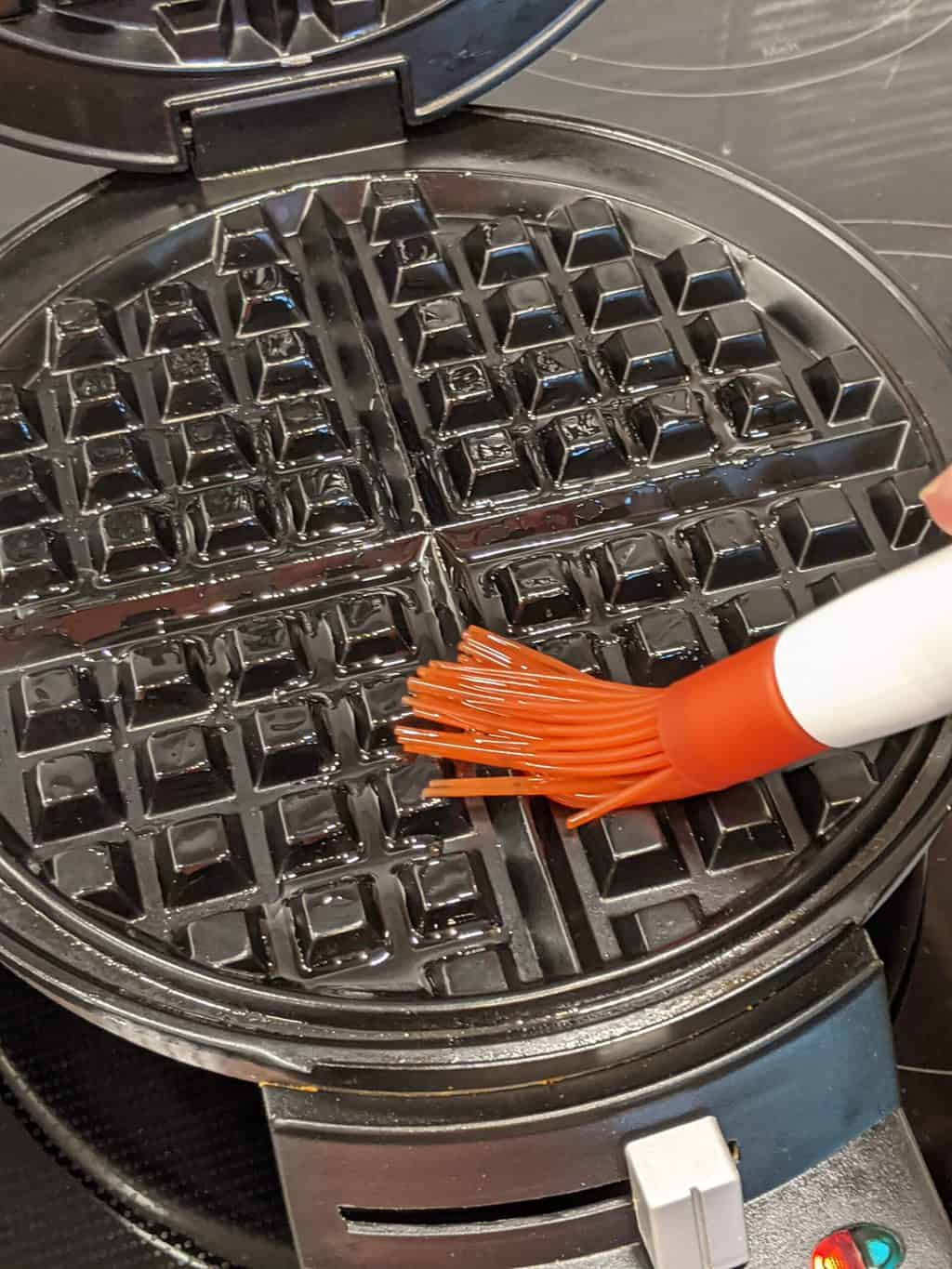 adding oil to a waffle maker
