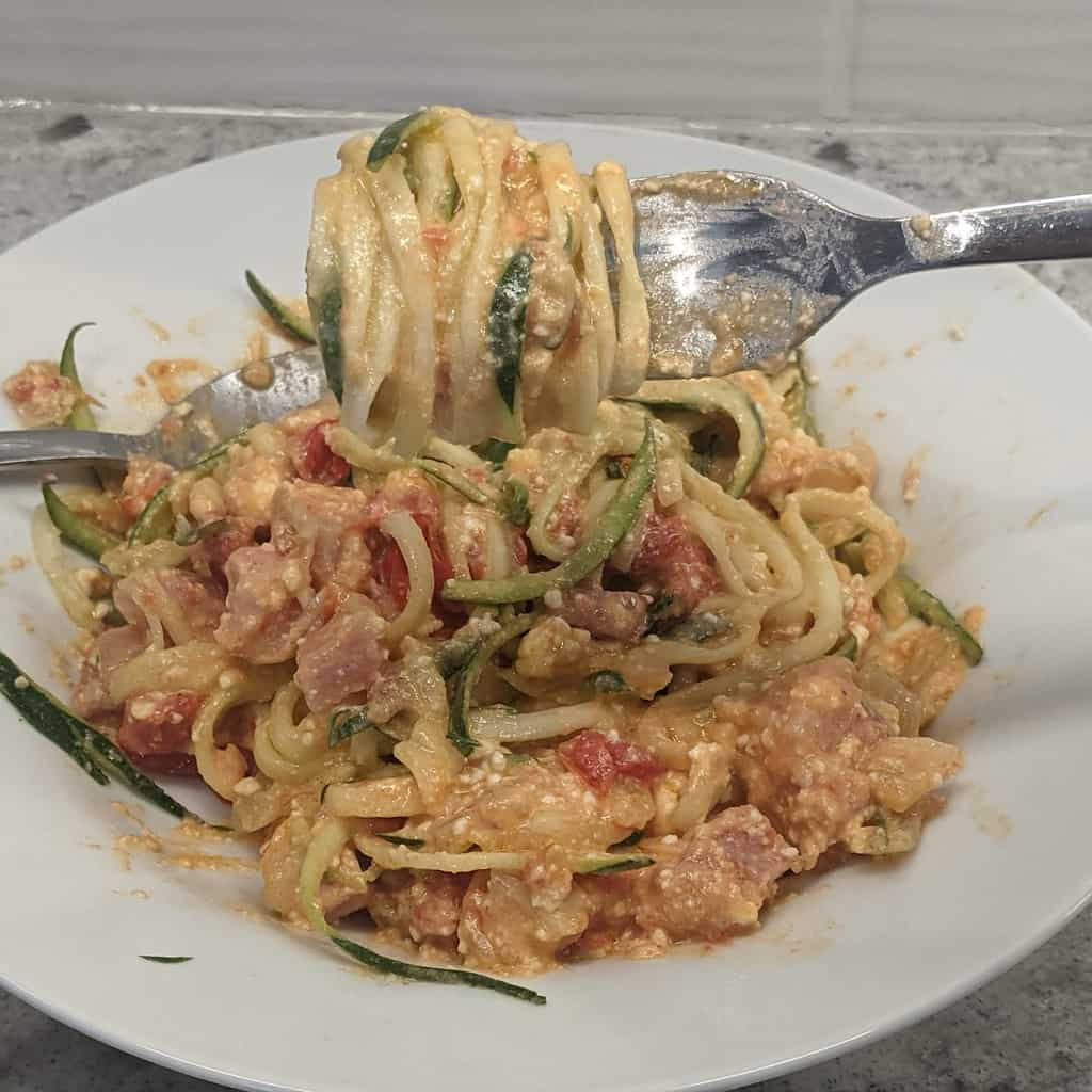 pasta sauce with zoodles swirled around a fork