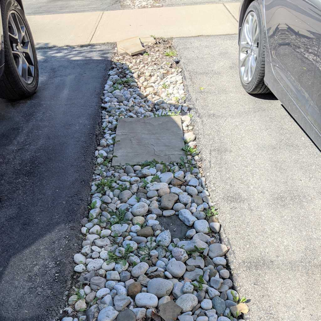 rocky path between two driveways