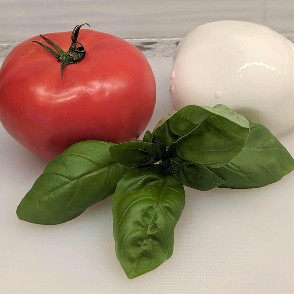 tomato mozzarella cheese ball and fresh basil