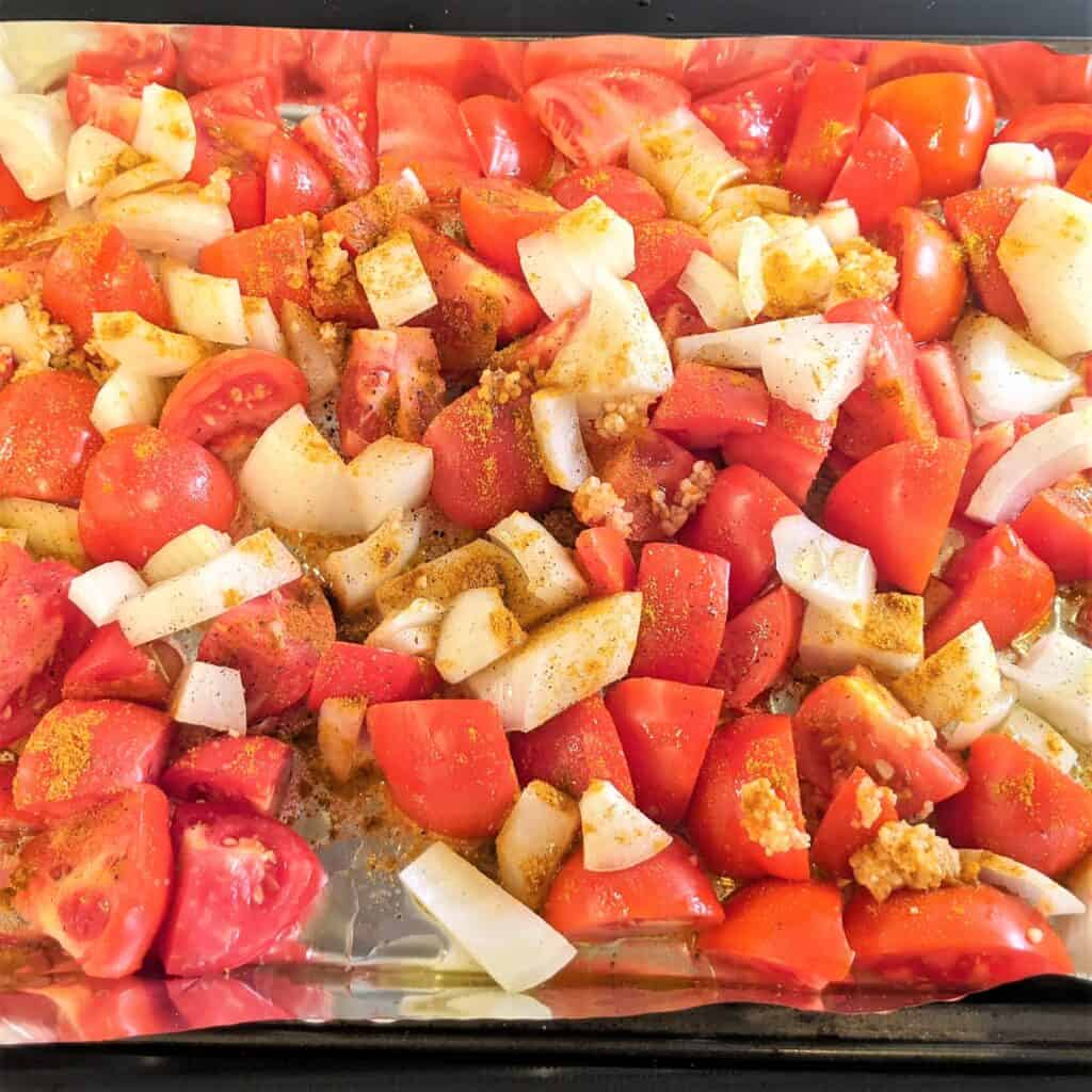 chopped tomatoes, onion and garlic, seasoned and placed on a baking sheet