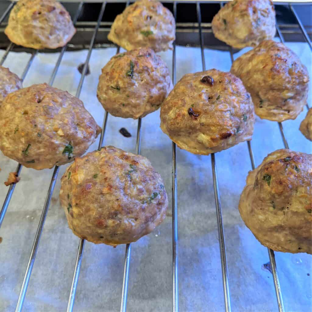 cooked turkey meatballs on a wire rack