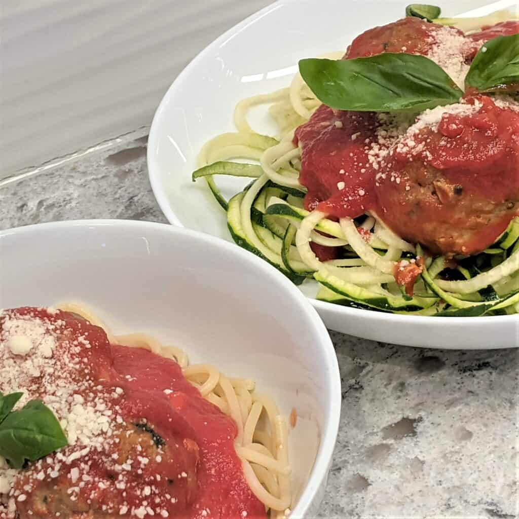 meatballs in tomato sauce over spaghetti and zoodles