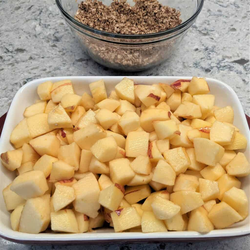 cubed apples in a baking dish