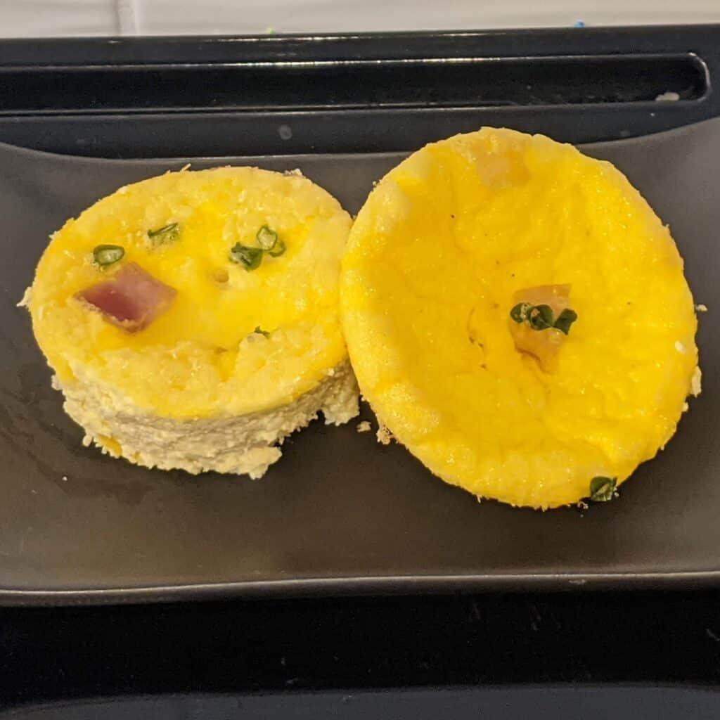 egg bites on a black platter