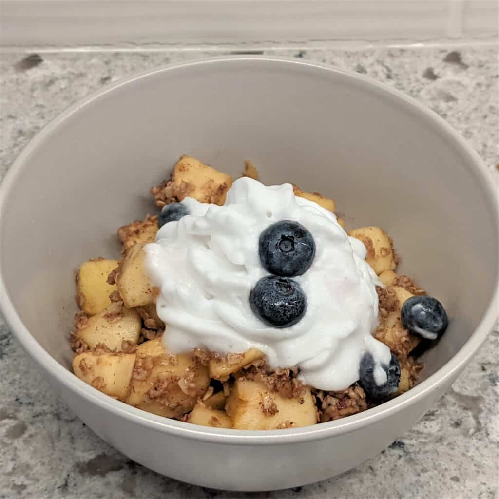 apple oatmeal bake with berries and whip cream