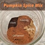 clove, nutmeg, cinnamon and ginger spices in a glass bowl